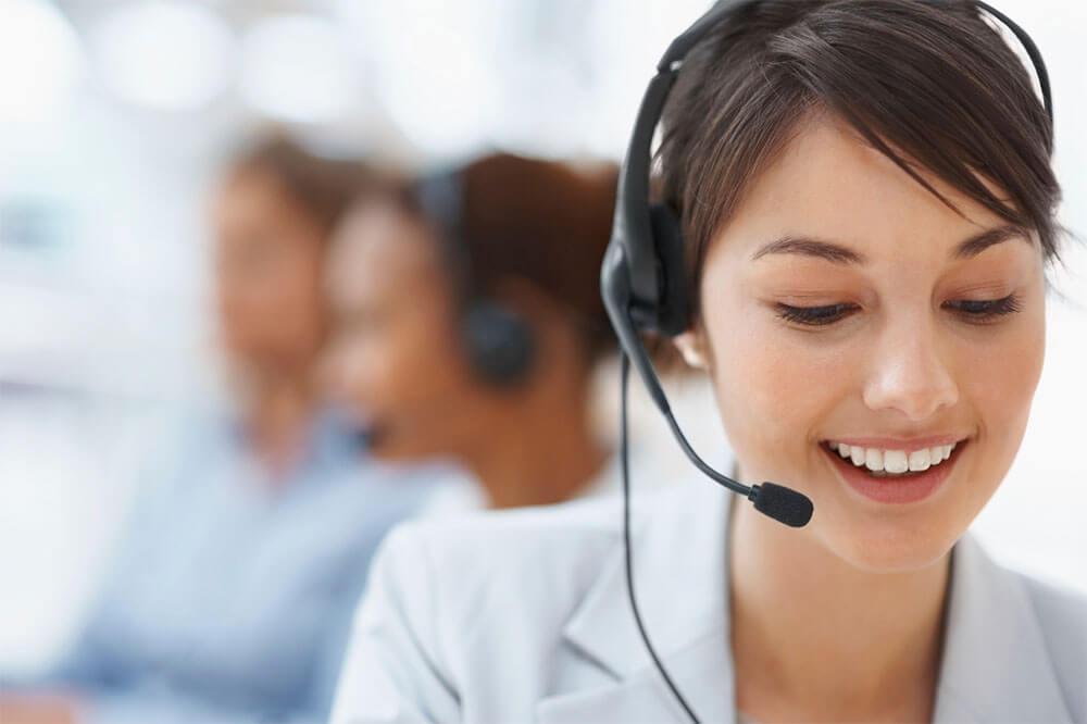 Women with headset in call centre